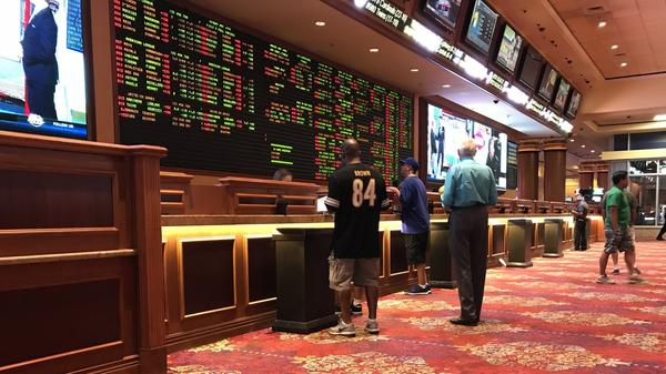 People place bets at the Sports Book at the South Point Hotel and Casino in Las Vegas. Missouri legislators are expected to take up legalizing sports betting in 2020.