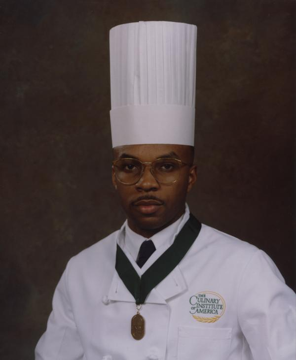 Ricky Moore graduating from the Culinary Institute of America.