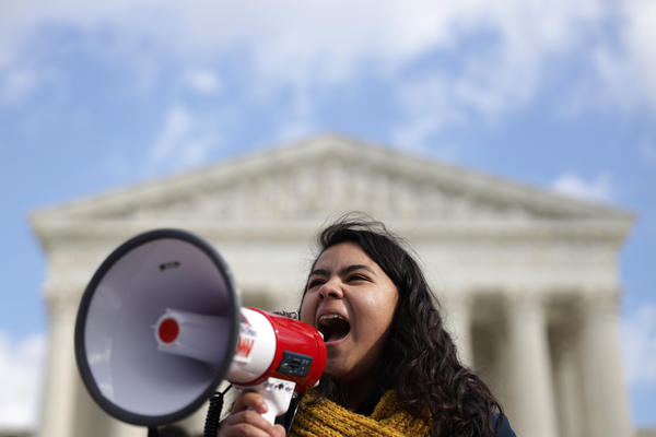 DACA recipient Anahi Figueroa Flores, who attends Georgetown University, speaks during a rally defending the Deferred Action for Childhood Arrivals program in front of the U.S. Supreme Court .