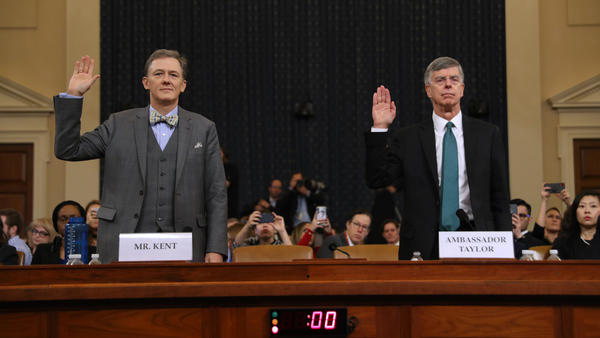 Deputy Assistant Secretary for European and Eurasian Affairs George Kent (left) and top U.S. diplomat in Ukraine William Taylor are sworn in before testifying before the House Intelligence Committee on Capitol Hill on Wednesday.