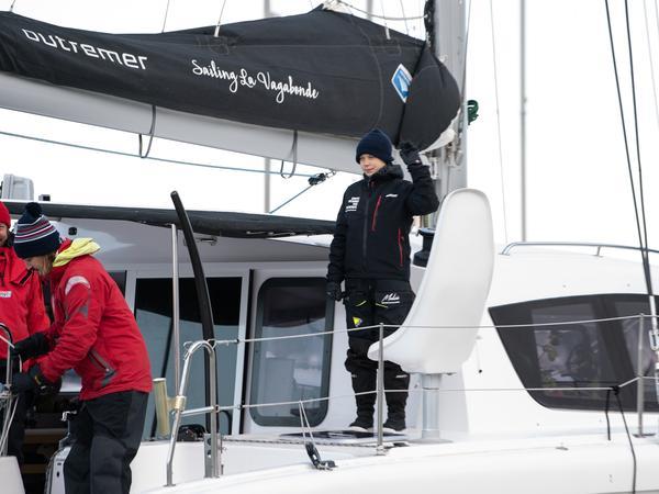 Swedish climate activist Greta Thunberg waves aboard the catamaran La Vagabonde as she sets sail for Europe from Hampton, Va., on Wednesday.
