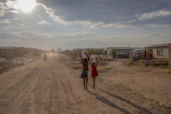 Girls carry containers of water filled from the local communal tap Zimbabwe, which is in the grip of a nationwide drought that has been linked to climate change. The government has appealed for $464 million in aid to stave off famine.