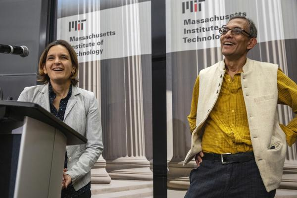 Esther Duflo, left, and Abhijit Banerjee speak during a news conference at Massachusetts Institute of Technology in Cambridge, Mass., Monday, Oct. 14, 2019. Banerjee and Duflo, along with Harvard's Michael Kremer, were awarded the 2019 Nobel Prize in economics for pioneering new ways to alleviate global poverty. (Michael Dwyer/AP)