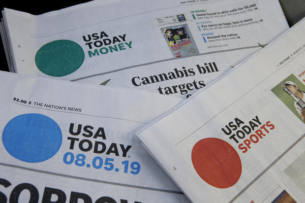 Sections of a USA Today newspapers rest together, Monday, Aug. 5, 2019, in Norwood, Mass. On Monday, Aug. 5, GateHouse Media, a chain backed by an investment firm, announced that it is buying USA Today owner Gannett Co.