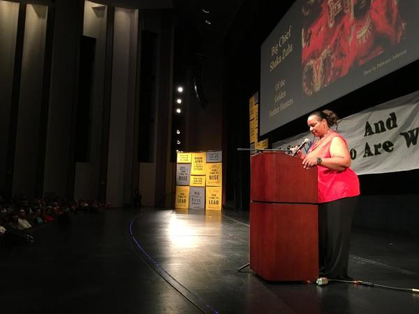 Colette Pichon Battle, executive director of the Gulf Coast Center for Law and Policy, addresses a crowd at the Mahalia Jackson Theater during the New Orleans stop of the national Green New Deal tour in May 2019.