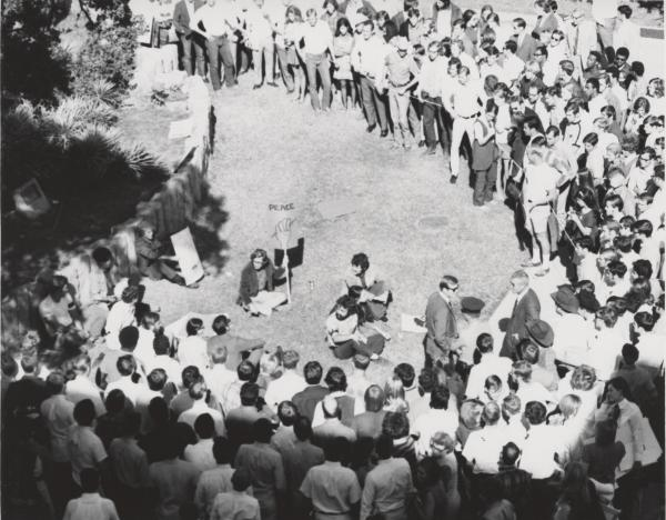 Ten students at then-Southwest Texas State University defied orders to end their antiwar demonstration and disperse. As they continued their defiance, a crowd of onlookers grew, some of them shouting and threatening the protestors.