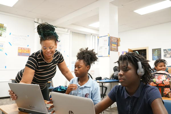 Monique Hines (left) teaches Janiaya Hubbard (middle) and Taniah Woods (right) the basics of music production.