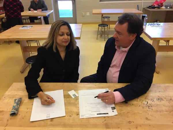 Attorneys Duriya Dhinojwala and Michael Steel co-founded the pro bono committee at Akron-based Brennan, Manna & Diamond. They participated in the free legal clinic offered by Community Legal Aid.