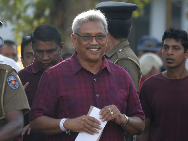 Sri Lanka's former Defense Secretary and presidential candidate Gotabaya Rajapaksa leaves a polling station after casting his vote in Embuldeniya, on the outskirts of Colombo, Sri Lanka on Saturday.