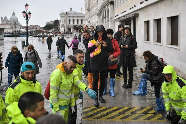 Volunteers set up a footbridge across Venice's flooded Riva degli Schiavoni embankment on Nov. 13.