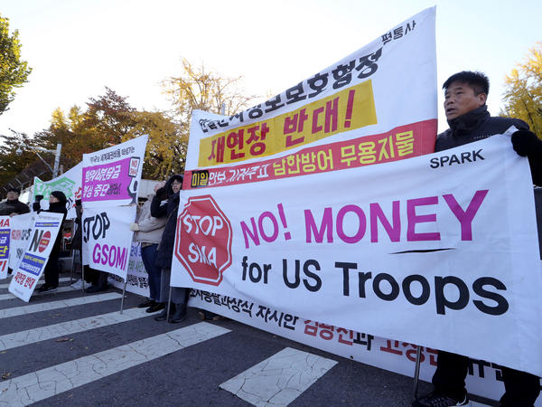 Protesters in Seoul, South Korea, on Nov. 14 march ahead of a visit by U.S. Defense Secretary Mark Esper.