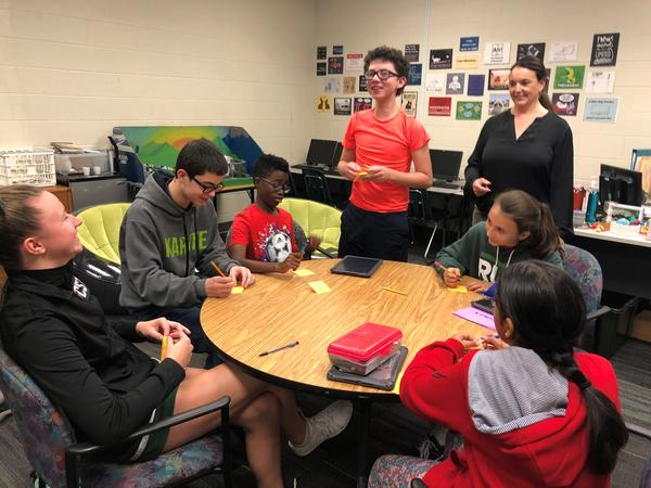Members of the Chisholm Trail Future Cities team and their coach, Deonne Hobson, brainstorm ideas for how to conserve water 100 years from now.