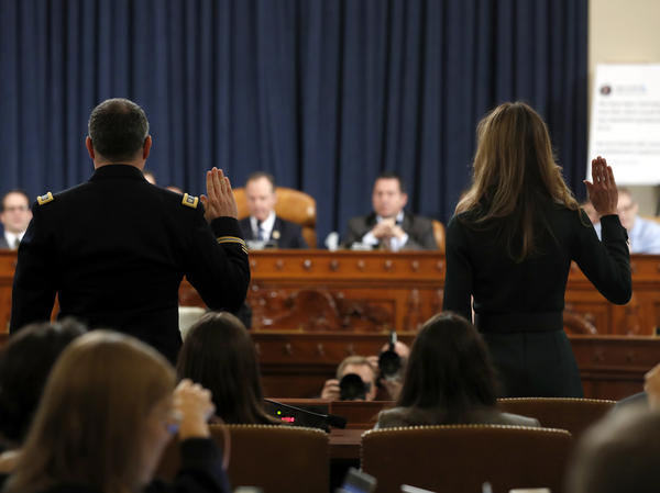 Jennifer Williams (right) and Lt. Col. Alexander Vindman are sworn in to testify before the House Intelligence Committee on Capitol Hill on Tuesday.