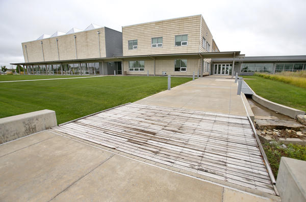 Greensburg, Kansas, built a new, environmentally friendly, high-tech high school after being hit by a massive tornado in 2007. But the town has barely half the population it did before the twister struck.