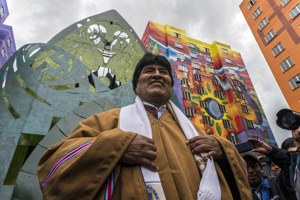 President Evo Morales attended the inauguration of new buildings in a housing project in 2016. The indigenous Aymara artist Roberto Mamani Mamani painted murals over a building facade.