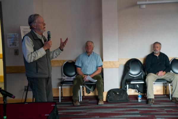 Fred Allendorf speaks during a Nov. 15, 2019 meeting in Missoula about grizzly bear connectivity. The meeting was called by five independent researchers. Organizers Jake Kreilick and Mike Bader are visible in the background.