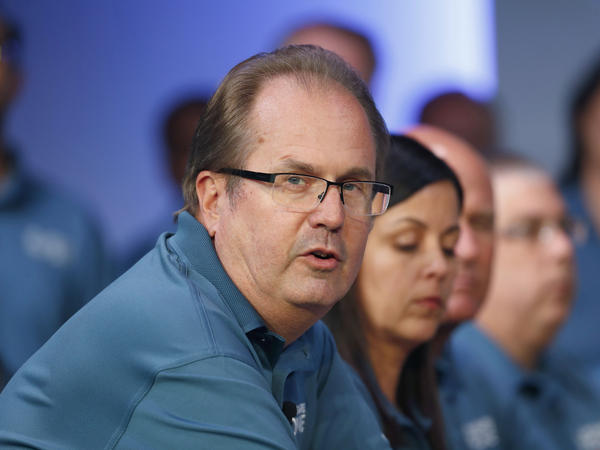 Former United Auto Workers President Gary Jones speaks during the opening of contract talks with Fiat Chrysler Automobiles in Auburn Hills, Mich., in July 2019. Jones resigned Wednesday.