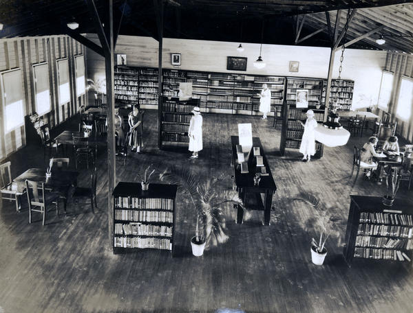 From 1915 until 1959, the Key West Woman's Club ran a library on the island. This photo is from the 1930s.
