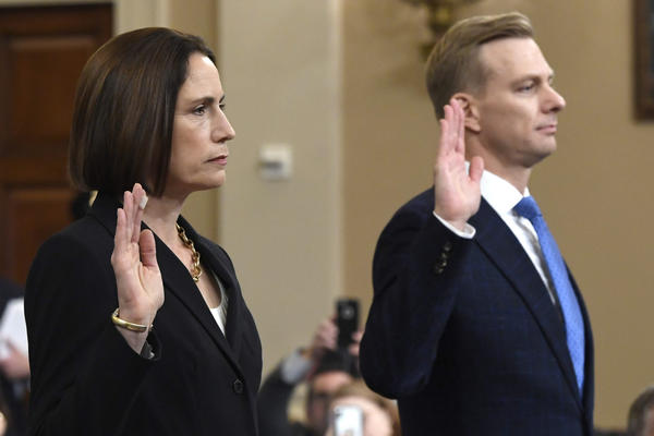 Former White House national security aide Fiona Hill, and David Holmes, a U.S. diplomat in Ukraine, are sworn in to testify before the House Intelligence Committee on Capitol Hill in Washington, Thursday, Nov. 21, 2019, during a public impeachment hearing of President Donald Trump's efforts to tie U.S. aid for Ukraine to investigations of his political opponents.(Susan Walsh/AP)
