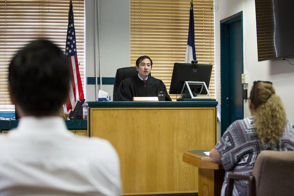 Travis County Justice of the Peace for Precinct 5 Judge Nick Chu presides over court in 2018.
