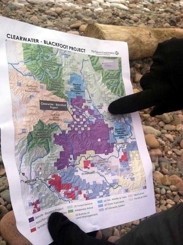A Nature Conservancy representative points out portions of the land that make up the Clearwater-Blackfoot Project in the Blackfoot Valley. January 2015.