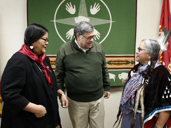 Attorney General William Barr speaks with Myrna DuMontier (left)<em> </em>and Charmel Gillin (right),<em> </em>councilwomen with the Confederated Salish and Kootenai Tribes on Friday on the Flathead Reservation in Pablo, Mont.