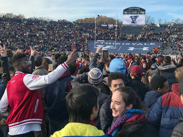 Demonstrators stage a protest on the field at the Yale Bowl disrupting the start of the second half of an NCAA college football game between Harvard and Yale, Saturday in in New Haven, Conn.