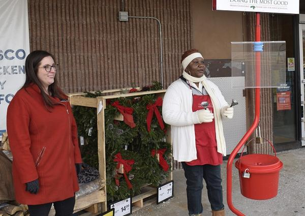 The Salvation Army's Angie Bubon, left, and bellringer Gennette Bramlette greet customers outside a Jewel-Osco store in Normal.