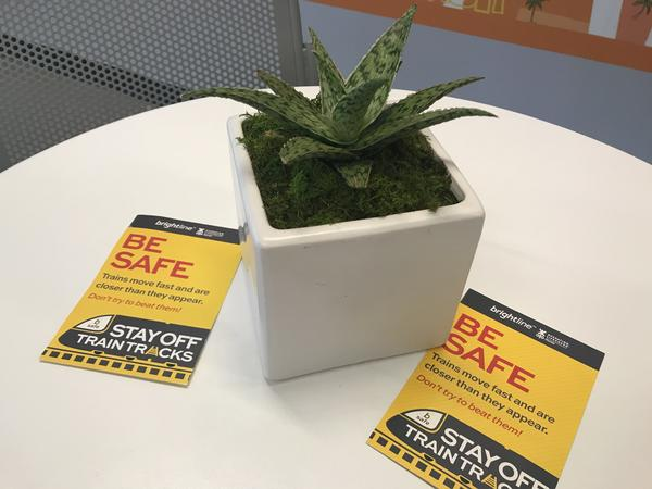 These train safety flyers sit on the tables at the Fort Lauderdale Brightline Train Station.
