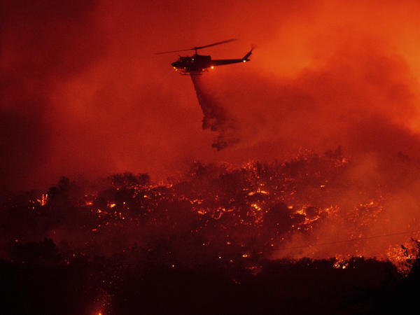 A helicopter drops water on the Cave Fire burning in the Los Padres National Forest above Santa Barbara, Calif., on Tuesday.