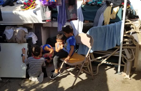 Children sit outside of a shleter in Nuevo Laredo.