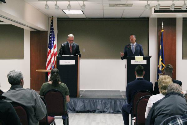 Attorney General Tim Fox and State Sen. Albert Olszewski meet in Helena Nov. 26, 2019 for a debate hosted by Carroll College.