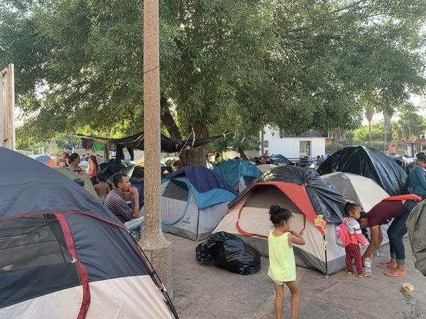 Asylum seekers at their encampment while they wait in Matamoros for their court hearings.