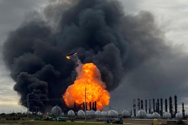 A process tower flies through air after exploding at the TPC Group Petrochemical Plant, after an earlier massive explosion sparked a blaze at the plant in Port Neches, Texas, on Wednesday.