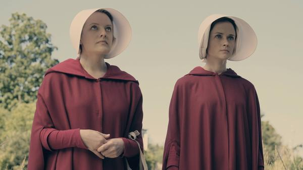 Elisabeth Moss and Alexis Bledel as the Handmaids Offred and Ofglen in Hulu's new limited series, <em>The Handmaid's Tale.</em>