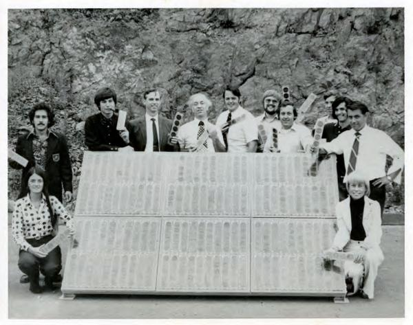 """Elliot Berman (center, in patterned tie) and his team at Solar Power Corp. pose outside their office and manufacturing facility in Braintree, Mass., in 1973. John Perlin, author of <em>Let It Shine: The 6,000-Year Story of Solar Energy,</em> credits Berman, Solar Power Corp. and Exxon with """"planting the flag of photovoltaics throughout the world."""""""
