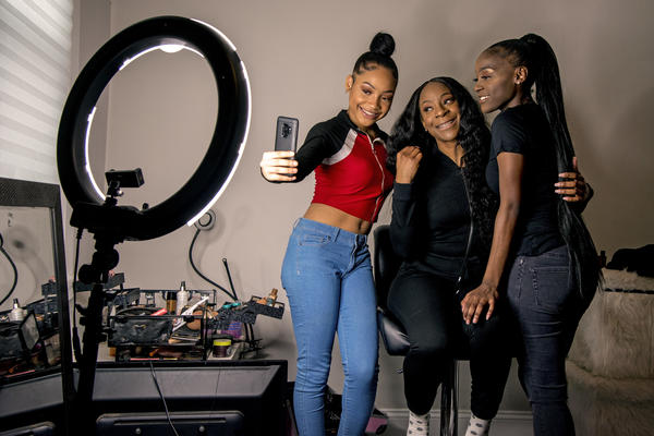 Years ago, Portia Smith (center) was afraid to seek care for her postpartum depression because she feared child welfare involvement. She and her daughters Shanell Smith (right), 19, and Najai Jones Smith (left), 15, pose for a selfie in February after makeup artist Najai made up everyone as they were getting ready at home to go to a movie together.