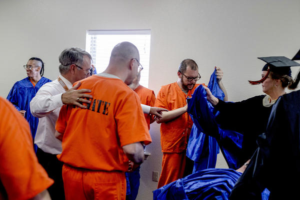 Inmates at the Dick Conner Correctional Center graduated from Tulsa Community College and Langston University in Hominy, Okla., in  June 2018. The graduation ceremony was held in the prison and family members were invited to attend.