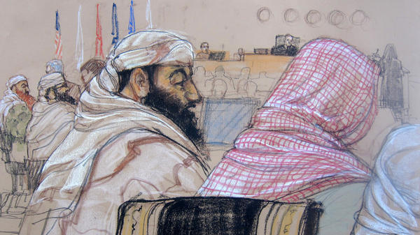In this Pentagon-approved courtroom sketch, defendant Ramzi Binalshibh (center) attends his pretrial hearing along with other defendants at the U.S. military court in Guantánamo Bay, Cuba, on April 14, 2014. Also depicted are Mustafa al-Hawsawi (from right), partially cut off; Ali Abdul Aziz Ali, Ramzi Binalshibh, Walid bin Attash and Khalid Sheikh Mohammed.