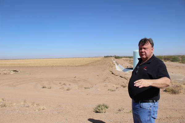 Patrick Johnson, president of Danrick Builders, at the corner of his 2,500-acre property in Pinal County. Johnson's application for a water supply determination is on hold.