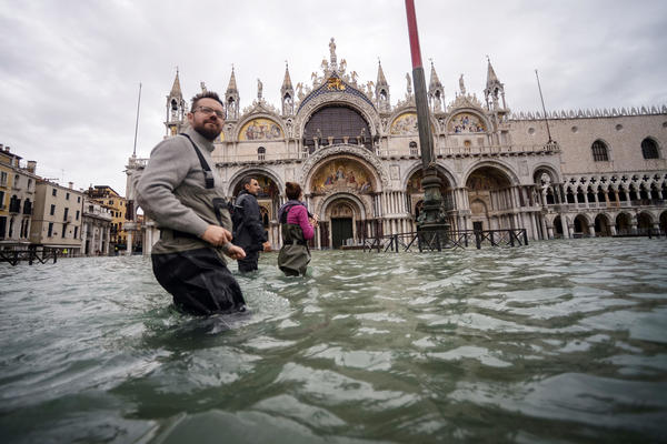 Tourists walk across flooded St. Mark's Square two days after Venice suffered its highest tide in 50 years.