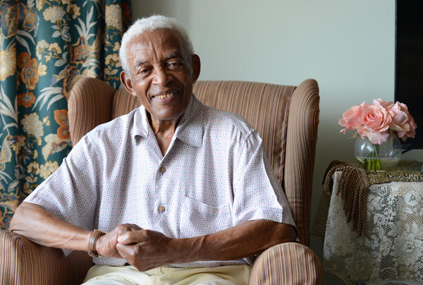 """Irving Burgie at his home in Queens in 2017. Burgie, who rewrote the lyrics to the traditional Jamaican song """"Day-O,"""" died Friday at the age of 95."""