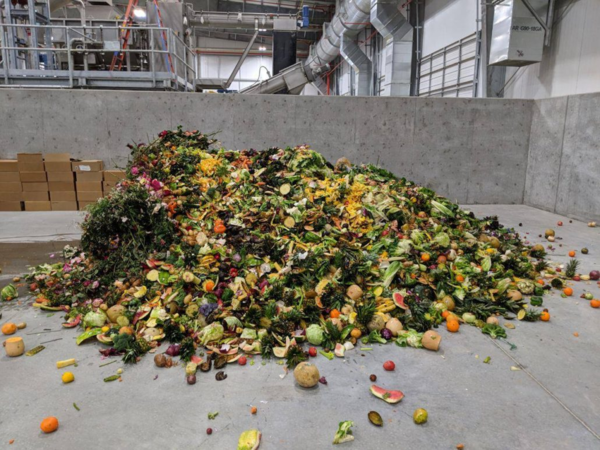 The first load of organic food waste on the receiving floor of Wasatch Resource Recovery in North Salt Lake, Utah.