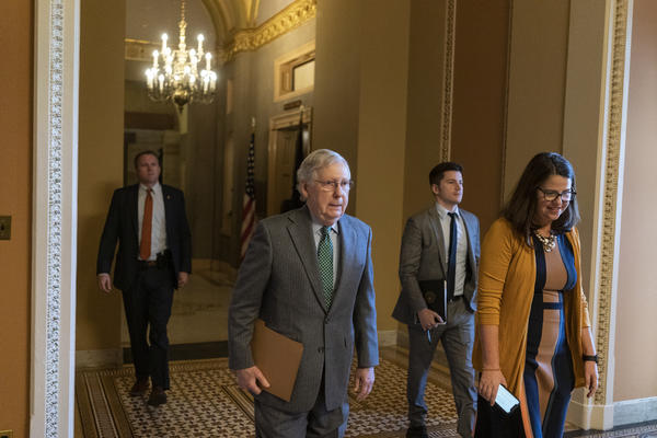 Senate Majority Leader Mitch McConnell (R-KY) walks from his office to the floor of the U.S. Senate to open the Senate for business.