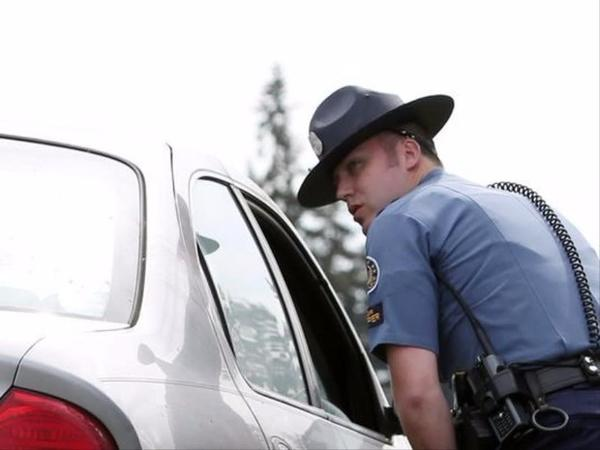 <p>Oregon State Police Senior Trooper Cameron Bailey pulls over a driver for speeding while patrolling for distracted drivers along a section of Interstate 5 in an unmarked patrol vehicle on Tuesday, April 5, 2016, during a ride along.</p>