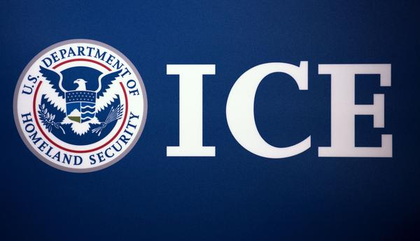 The Immigration and Customs Enforcement (ICE) seal is seen before a press conference discussing ongoing enforcement efforts to combat human smuggling along the Southwest border of the United States.