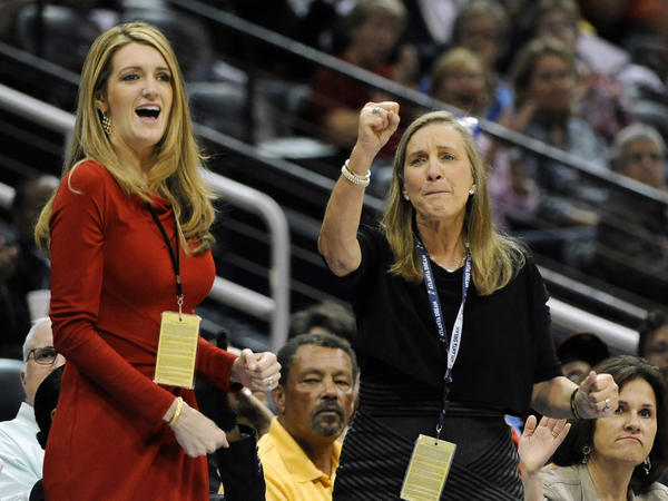 Kelly Loeffler (left) and Mary Brock, co-owners of the Atlanta Dream WNBA team, cheer from their courtside seats at a game in 2011. Loeffler was appointed to fill a soon-to-be vacant U.S. Senate seat representing Georgia.