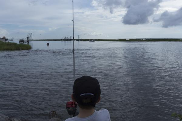 A boy fishes on a bayou near the Isle de Jean Charles, Louisiana.