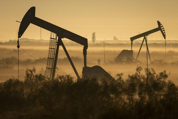 Northeast of Kermit in Andrews County, pump jacks pull oil from Texas' Permian Basin.
