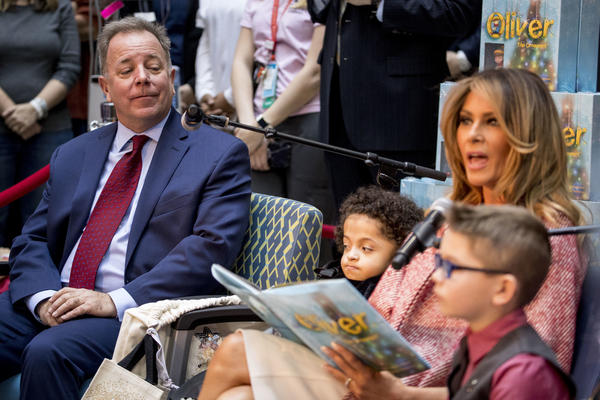 """First lady Melania Trump, accompanied by author Todd Zimmermann, left, Tearrianna Cooke-Starkey, second from left, and Nathan Simm right, reads """"Oliver the Ornament"""" to children at Children's National Health System, Thursday, Dec. 13, 2018, in Washington."""